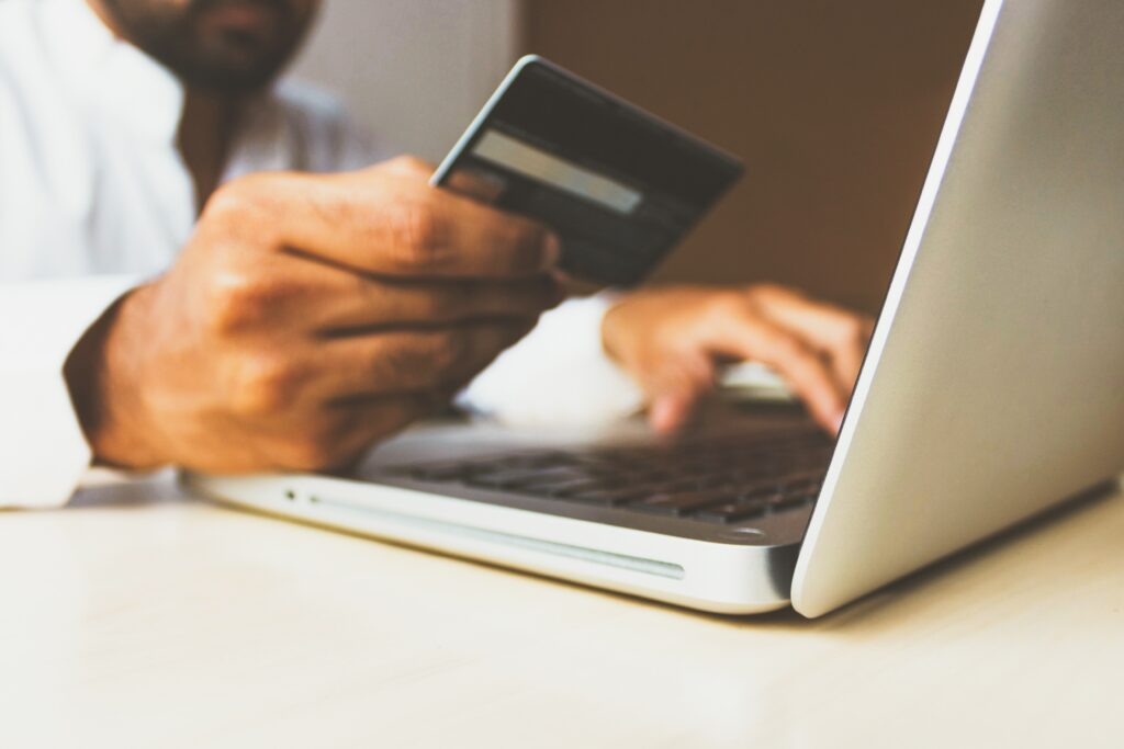 A Man Using a Credit Card from Unsplash